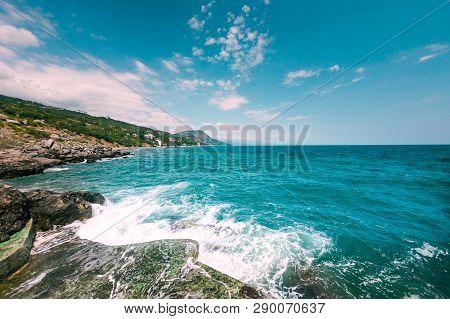 Storm On The Sea Coast. Stony Shore Of The Ocean. Waves Breaking On The Stone Coast. Fisheye Lens.