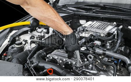 Car Detailing Maintenance. Cleaning Engine With Hot Steam. High Pressure Washing. Washing At The Sta