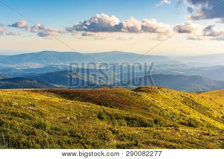 Gorgeous Summer Mountain Landscape At Sunset. Fluffy Clouds On A Blue Sky Above The Hills In Golden