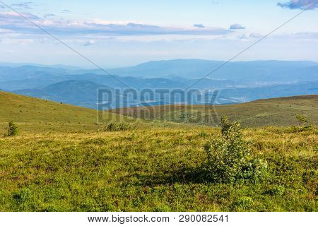 Beautiful Summer Landscape In Mountain. Rolling Hills With Alpine Meadows In Evening Light. Ridge In