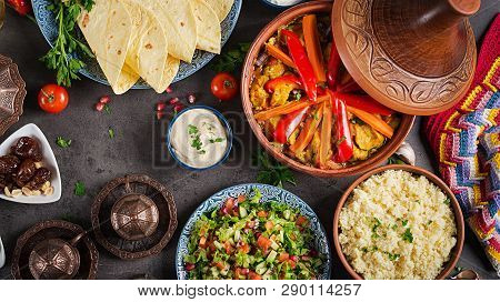 Moroccan Food. Traditional Tajine Dishes, Couscous  And Fresh Salad  On Rustic Wooden Table. Tagine