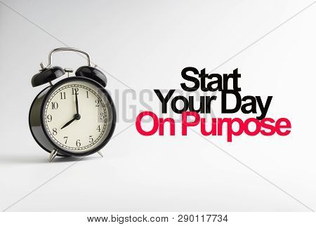 Start Your Day On Purpose Inscription Written And Alarm Clock On White Background. Business And Moti