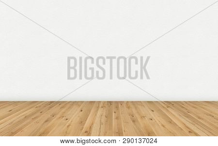 Empty Room With Brown Wooden Floor And Blank White Painted Wall. Empty Loft Room For Design Interior