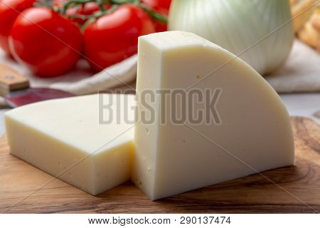 Italian Cheese, Provolone Dolce Cow Cheese From Cremona Served With Olive Bread And Tomatoes
