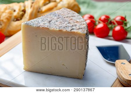 Italian cheese, piece of mature Tuscan Pecorino sheep cheese served with olive bread and tomatoes close up poster