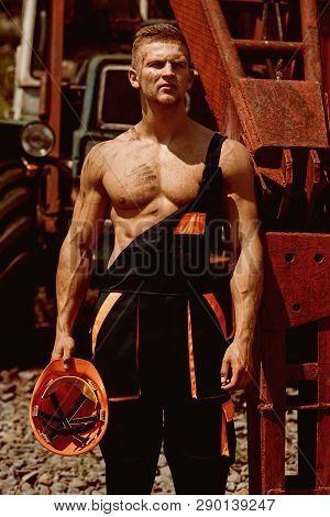Metal Worker. Metal Worker Rest At Heavy Machinery. Handsome Metal Worker In Working Uniform. Strong