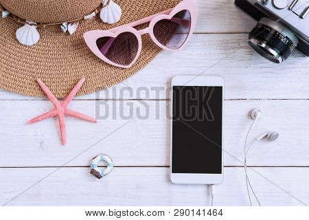 Beach Hat With Travel Items And Smart Phone On White Wooden Background, Summer Vacation Concept