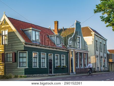 Street With Typical Zaans Houses - Amsterdam Area. Summer Scene Of Real Life In Early Morning.