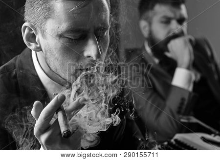 Thinking About Problem Solution. Thoughtful Man Smoking Cigar. Businessmen Hold Business Meeting. Bu
