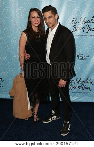 NEW YORK-APR 14: Amy Acker and James Carpinello attend the Broadway opening night for 'It Shoulda Been You' at Brooks Atkinson Theatre on April 14, 2015 in New York City.