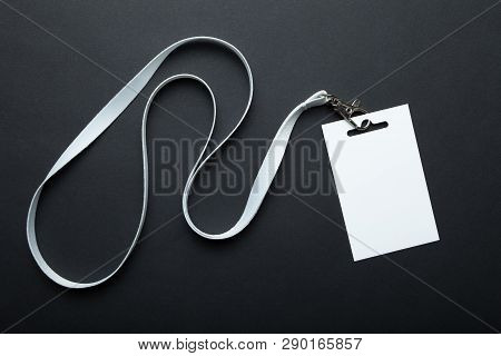 Blank Badge Mockup Isolated On Black. Plain Empty Name Tag Mock Up Hanging On Neck With String. Name