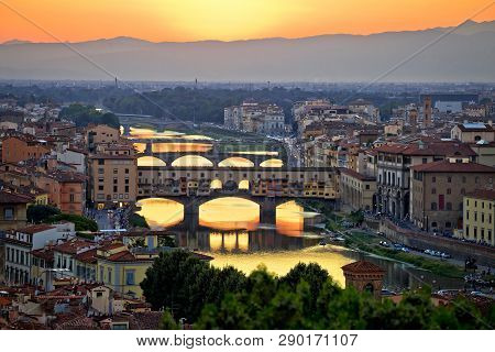 Florence cityscape and Arno river bridges sunset view, Ponte Vecchio, Tuscany region of Italy poster