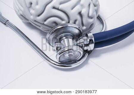 Stethoscope Or Phonendoscope Examine The Brain, Lying On A White Medical Table View From Above. Idea