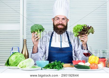 Man Cook Hat And Apron Hold Broccoli. Organic Vegetables. Healthy Nutrition Concept. Bearded Profess