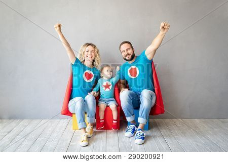 Family Of Super Heroes Playing At Home