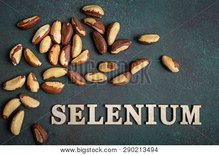 Brazil Nuts On Dark Background And Text Selenium