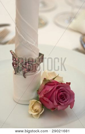 Napkin in the plate-wedding dinner. Shallow depth of field, focus on the flower