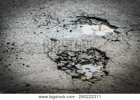 The Hole In The Road. Asphalt With Defects. Dangerous Encounter On The Road.