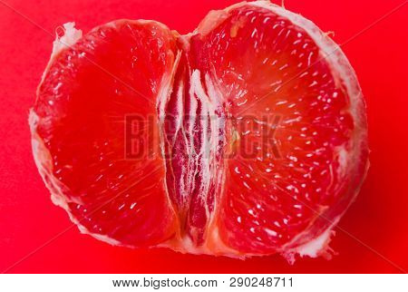 Concept Sex, Masturbation. Grapefruit, Vagina Symbol On Coral Background