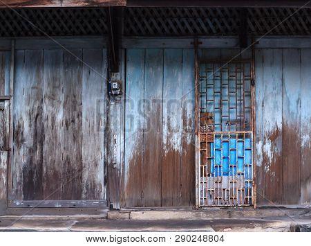 Vintage Retro Wooden Door And Slide Lock. Home Interior Architectural Design, Plain Tropical Blue Pa