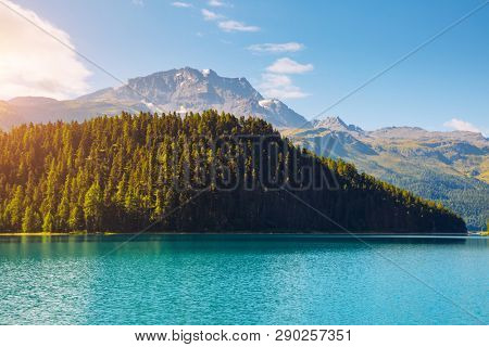 Alpine lake Champfer in beautiful summer day. Location place Silvaplana village, Swiss alps, district Maloja, Europe. Scenic image of most popular vacation destinations. Discover the beauty of earth.