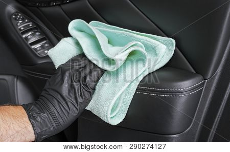 A Man Cleaning Car Seat With Blue Microfiber Cloth. Car Detailing Or Valeting Concept. Selective Foc