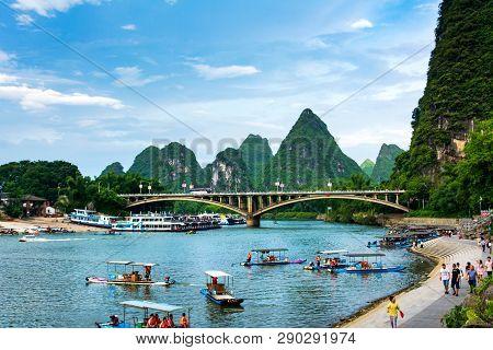 Yangshuo, China - July 27, 2018: Tourist Bamboo Rafts On Li River In Yangshuo Near Guilin A Famous T