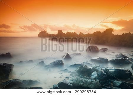 Sunset View Over The Beach With Rock