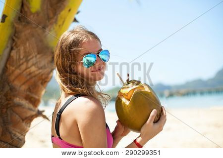 Photo Of Beautiful Woman In Mirror Glasses Posing With Young Coconut Cocktail
