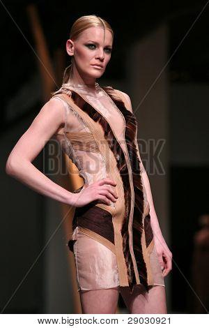 ZAGREB, CROATIA - APRIL 2: Fashion model wears clothes made by Hippy Garden in 'Croaporter' show, April 2, 2011 in Zagreb, Croatia.