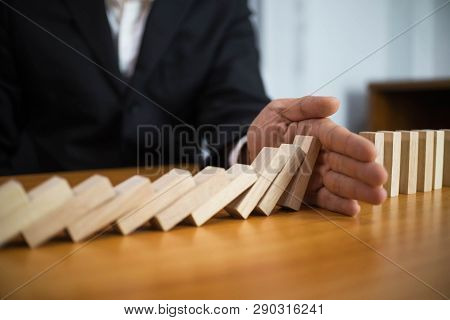 Businessman Hand Stops Domino Continuous Overturned Meaning That Hindered Business Failure. Stop Ove
