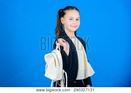 Shopping Time. Cute Child Holding Bag On Blue Background. Little Girl Going Shopping With Daypack Ba