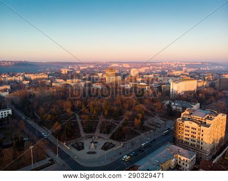 Aerial Drone View Of Stefan Cel Mare Central Boulevard At Sunrise In Chisinau With Cars, Moldova