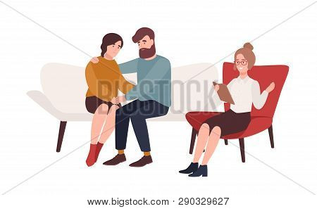Happy Married Couple On Couch And Female Psychologist Or Psychotherapist Sitting In Front Of Them. R
