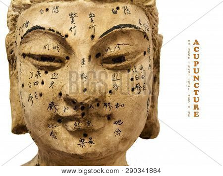 Ancient Wooden Female Face Showing Acupuncture Points, Isolated On White Background
