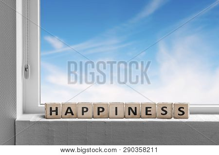 Happiness Sign In A Window Sill With A View To Ablue Sky On A Bright Day