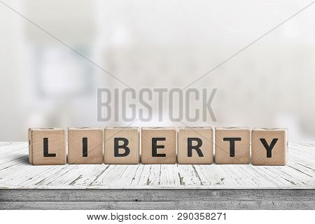 Liberty Sign Made Of Wood On A Desk In An Indoor Environment