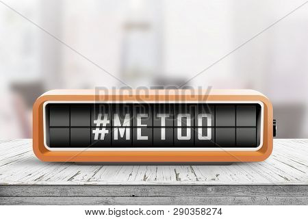 Metoo Hashtag Message On A Retro Alarm Device In A Bright Room On A Table
