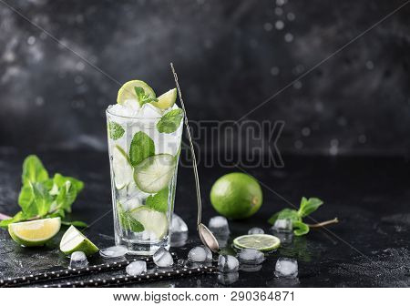Mojito Cocktail With Lime And Mint In Highball Glass On A Dark Stone Background. Fresh Summer Cockta