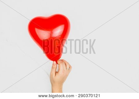 Red blown up heart shaped balloon poster