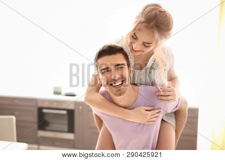 Cute young couple dancing indoors