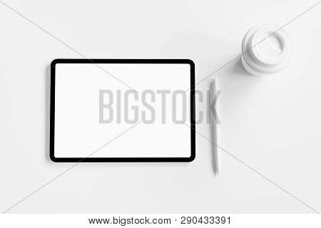 Tablet Screen Blank On The Table Mock Up To Promote Your Products. Concept Of Future And Trend Inter