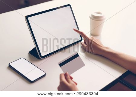 Woman Holding Smartphone Mock Up Of Blank Screen And Credit Card On The Table. Concepts Online Shopp