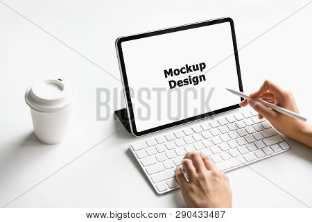 Woman Typing Keyboard Laptop And Tablet Screen Blank On The Table Mock Up To Promote Your Products.