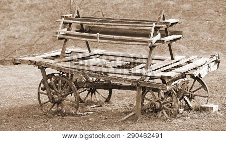 Old Broken Wooden Chariot Of Pioneers With Sepia Toned Effect