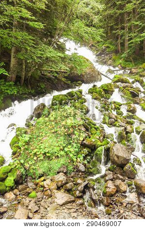 Waterfall Uelhs Deth Joeu. Aran Valley In The Catalan Pyrenees, Spain