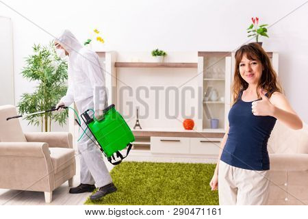 Young professional contractor doing pest control at flat