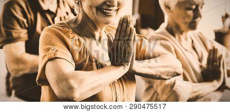 Seniors doing yoga in a retirement home