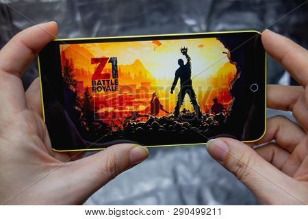 Berdyansk, Ukraine - March 18, 2019: Closeup Of Phone Screen With H1z1 Battle Royale Mobile Game Pla