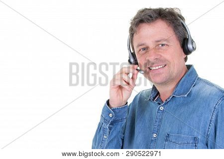 Consultant On The Phone With Headset With Side Copyspace In Callcenter